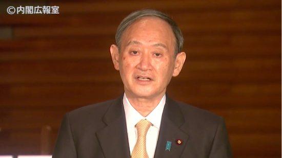 会見に応じる菅首相